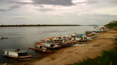 Boats line the Amazon River in Brazil. Stock Footage
