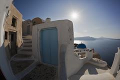 Greece, Cyclades, Thira, Santorini, View of stairs with blue door and aegean sea Stock Photos