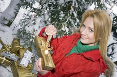 Austria, Salzburger Land, Young woman holding Christmas parcel, elevated view - stock photo