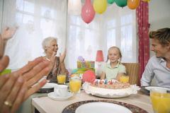 Family celebrating a birthday Stock Photos
