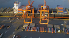 Aerial view Container Ship unloading freight Port of Seattle Stock Footage