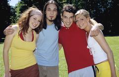 Four young people standing in garden, portrait Stock Photos