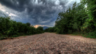 Stock Video Footage of Storm Clouds Over A Mountain Road.  HDR Time Lapse Shot Motorized Slider