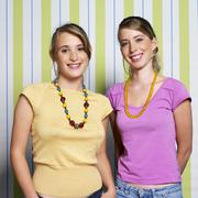Two teenage girls (16-17) smiling, portrait - stock photo