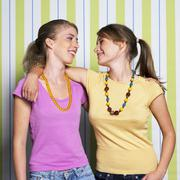 Two teenage girls (16-17) embracing, portrait Stock Photos