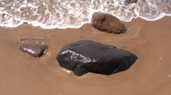 Sea beach wet stone and waves Stock Footage