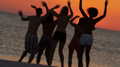 Teenagers Silhouette Dancing Beach Sunset - stock footage