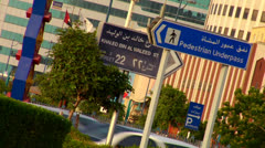 Signs in English and Arabic line a highway in the United Arab Emirates. Stock Footage