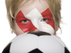 Boy (10-12), austrian football fan, holding football, close-up Stock Photos