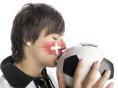 Swiss fan kissing football Stock Photos