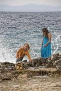 Croatia, Korcula, Girls (8-13) enjoying at seashore - stock photo