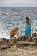 Croatia, Korcula, Girls (8-13) enjoying at seashore Stock Photos