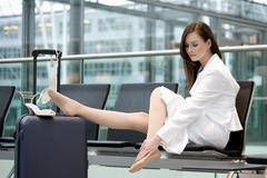 Business woman sitting in airport lounge Stock Photos