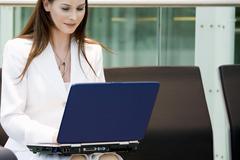 Business woman using laptop Stock Photos