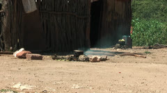 African native tribes - Young Himba boy in front of hut in Namibia Stock Footage
