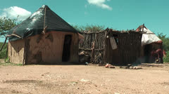 African native tribes - Young Himba woman in front of her hut in Namibia Stock Footage