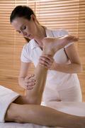 Stock Photo of wellness: man receiving leg massage