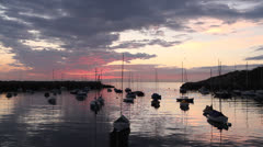 Boats tied in harbor, dawn, summer in New England Stock Footage