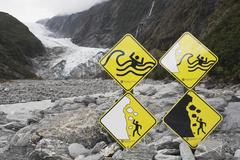 New Zealand, South Island, Danger attention signs at Franz Josef glacier Stock Photos