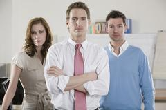 Germany, Munich, three Business people in office, portrait Stock Photos