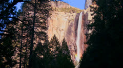 A beautiful waterfall in Yosemite National park casts a rainbow. Stock Footage