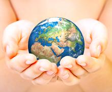 hand of the person holds globe. - stock photo