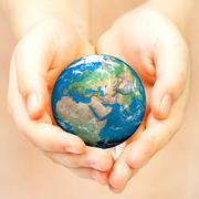 Hand of the person holds globe. Stock Photos
