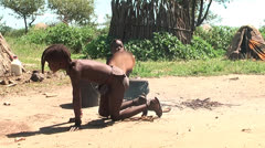 African native tribes - Young Himba boy cooking on open fire in Namibia Stock Footage