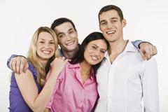 Group of people embracing, smiling, portrait - stock photo