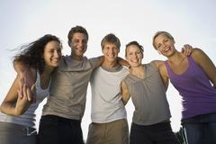 Germany, Bavaria, Young people embracing, laughing, portrait, close-up - stock photo