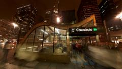 People enter and exit Consolacao subway station on Avenida Paulista Stock Footage