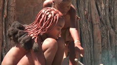 African native tribes - Young Himba woman cooking on open fire in Namibia Stock Footage