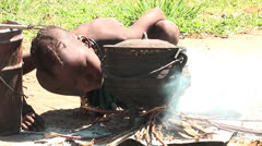 African native tribes - Young Himba boy making fire in Namibia Stock Footage