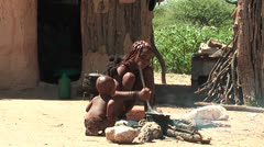 African native tribes - Young Himba girl cooking on fire in Namibia Stock Footage
