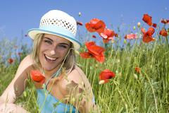 Stock Photo of germany, bavaria, young woman in poppy field