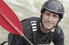 Austria, Salzburger Land, Man wearing safety helmet holding oar, portrait, Stock Photos