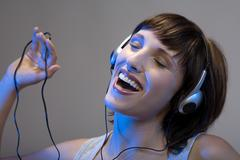 Woman listening to music, close-up Stock Photos