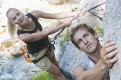 Austria, Steiermark, Ramsau, Silberkarklamm, Young couple rock climbing Stock Photos