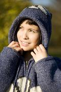 Germany, Bavaria, Woman wearing hooded jacket, portrait - stock photo