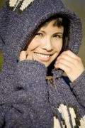 Germany, Bavaria, Woman wearing hooded jacket, portrait, smiling - stock photo