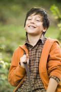 Teenage boy (13-15) smiling, portrait Stock Photos