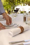 waiter laying table - stock photo