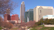 Stock Video Footage of Downtown Omaha Nebraska skyscrapers rise above a city park.