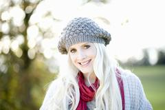 Stock Photo of Young woman wearing cap, smiling, portrait