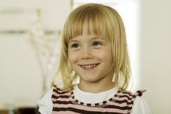 Stock Photo of girl (2-4) smiling, looking away, close-up