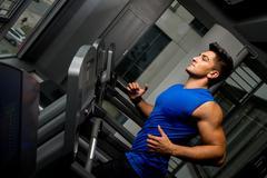 running on treadmill in gym - stock photo