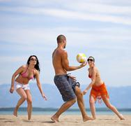 Croatia, Zadar, Friends playing volley ball at beach - stock photo