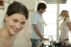 Woman smiling, portrait, couple in background Stock Photos