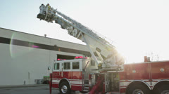 Firefighters on fire truck latter Stock Footage