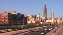 Time lapse of cars drive on a freeway heading into Chicago, Illinois. Stock Footage